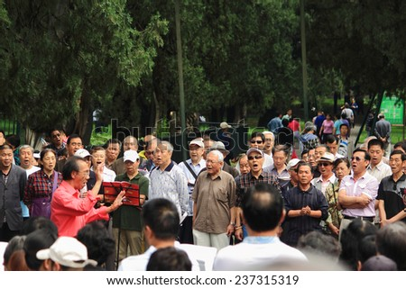 BEIJING, CHINA - JUNE 9, 2013: chinese people sing in park, Beijing, China on 9th June, 2013