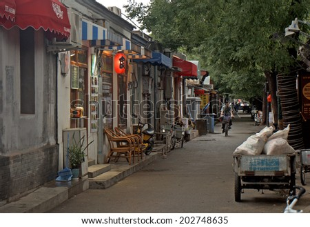 BEIJING, CHINA - JUNE 6: Hutong on June 6, 2014, Beijing, China. Hutongs are the old quarters of Beijing, still hundred thousands of people are living there. - stock photo