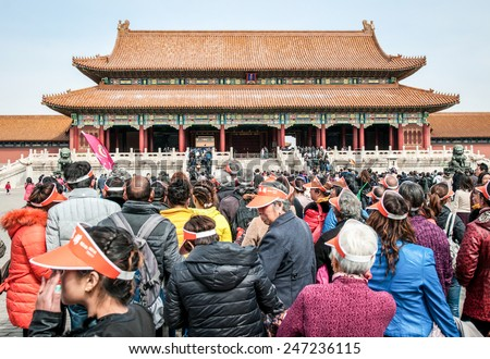 BEIJING, CHINA - MARCH 28: A large group of Chinese tourists waiting for pass through the Gate of Supreme Harmony in Forbidden City on March 28, 2013 in Beijing - stock photo