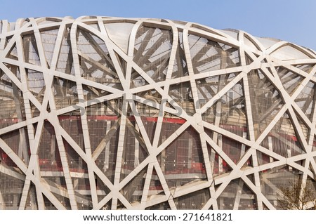 Beijing, China - March 26, 2015: Beijing  bird's nest ational stadium,Building is by the Swiss architects: herzog and Meuron design, they are the 2001 Pritzker Architecture Prize winner - stock photo