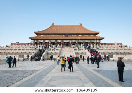 BEIJING, CHINA - MARCH 28: Chinese and foreign tourists walks in front of Hall of Supreme Harmony (Taihedian) on the Outer Court of Frobidden City on March 28, 2013 in Beijing - stock photo