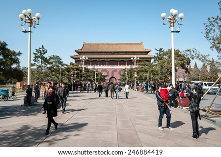 BEIJING, CHINA - MARCH 27: Chinese tourists walking to Forbidden City after passing Tiananmen (Gate of Heavenly Peace) on March 27, 2013 in Beijing - stock photo
