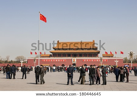 BEIJING, CHINA - MARCH 16, 2009: Crowds of tourist people walk on Tiananmen Square which is a Symbol of PRC in Beijing, China. - stock photo
