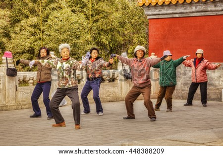 Beijing, China: 19 March 2011 - Group of women performing tai chi or taiji outdoors at Jingshan Park, Beijing.