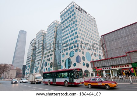BEIJING, CHINA - MARCH 30: Guanghualu SOHO building at Guanghua Rd with China World Trade Center Tower 3 on background, Central Business District (CBD), Chaoyang District on March 30, 2013 in Beijing - stock photo