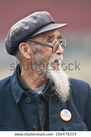 BEIJING, CHINA - MARCH 26: portrait of old Chinese man visits in famous Temple of Heaven religious complex on March 26, 2013 in Beijing - stock photo