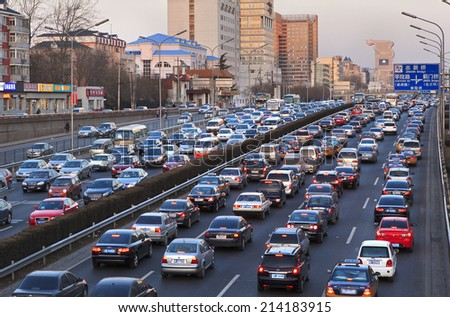 BEIJING, CHINA - MARCH 1, 2011: Traffic jam on ring road during rush hour at dusk. Beijing is rated as the third highest current traffic load in China. - stock photo