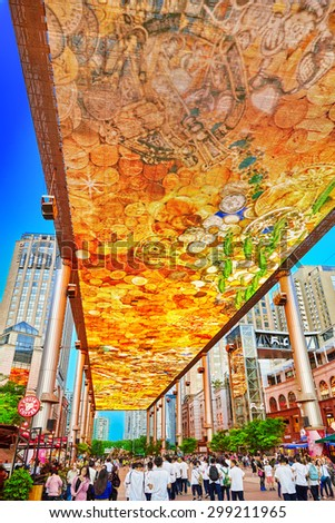 BEIJING, CHINA - MAY 20, 2015: Biggest screen of LSD in the world installed in Beijing, on the Jia No.9 Guanghua Road street for the purpose of advertising. Beijing (Pekin) .China - stock photo