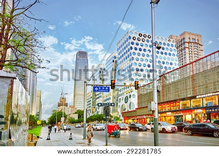 BEIJING, CHINA - MAY 20, 2015: Modern office and residential buildings on the streets of Beijing, transport and ordinary urban life of the city. - stock photo