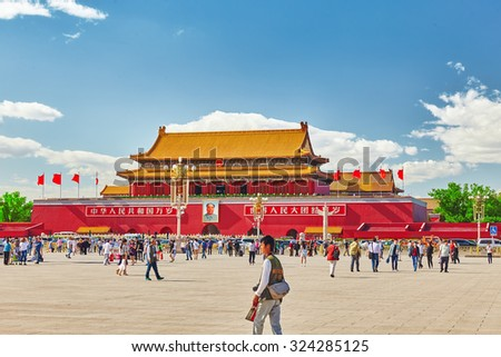 BEIJING, CHINA - MAY 19, 2015: People,  citizens of Beijing, walk on Tiananmen Square - the largest square in the world, Beijing. China. - stock photo