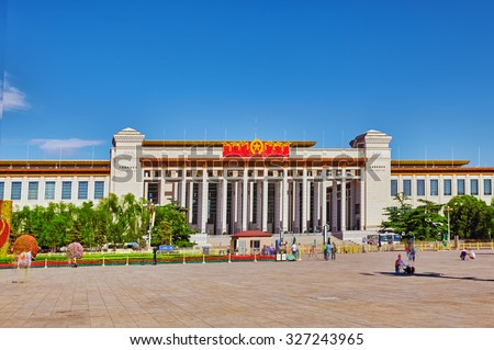 BEIJING, CHINA - MAY 19, 2015: People,  citizens of Beijing, walk on Tiananmen Square - the largest square in the world, Beijing. National Museum of China. China. - stock photo