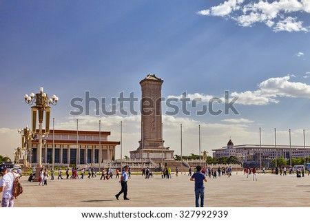 BEIJING, CHINA - MAY 19, 2015: People near Monument to the People's Heroes on Tian'anmen Square - the third of largest square in the world, Beijing, China - stock photo