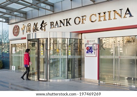 BEIJING, CHINA - NOV.30, 2013: People is seen at a Bank of China branch. Bank of China is one of the big four state-owned commercial banks of China and it is the second largest lender in China overall - stock photo