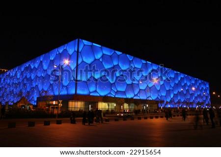 "Beijing, China - November 8: Beijing's swimming Olympic Stadium (""watercube"") illuminated at dusk on November 1st, 2008 after the 2008 Olympic Games (August, 2008). - stock photo"