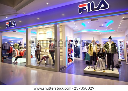 BEIJING, CHINA - NOVEMBER 13, 2014: Winter clothes are on display at a Fila store; Fila, one of the largest sportswear manufacturing companies in the world, has offices in 11 countries.   - stock photo