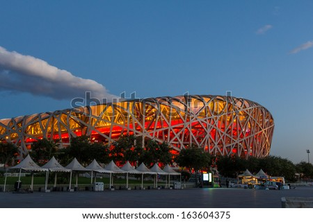 BEIJING, CHINA - OCT 10: The Beijing National Stadium, also known as the Bird's Nest on Oct 10, 2013 in Beijing. This Olympic venue is regarded as one of the Beijing's Top 10 tourist attractions.  - stock photo