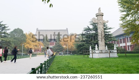 BEIJING, CHINA - OCTOBER 24, 2014: Traditional Chinese buildings in a heavy hazy weather. Located in Peking University, Beijing, China. - stock photo