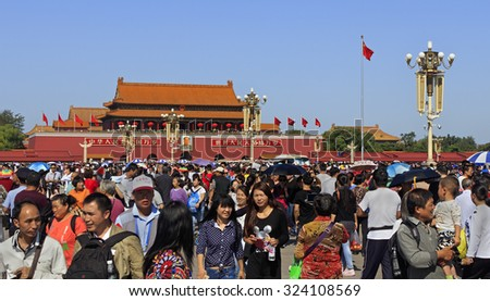 BEIJING, CHINA - OCTOBER 2, 2015: Unidentified people crowd Tiananmen Square  during the National Day holiday, celebrating the 66th anniversary of the founding of the People's Republic of China. - stock photo