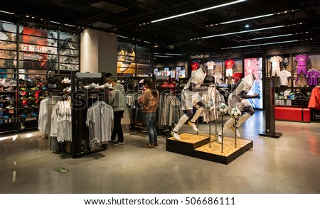 BEIJING, CHINA -OCTOBER 16, 2016: Unidentified people is seen at an Adidas store; Adidas, a German multinational corporation founded in 1948, is the second biggest sportswear manufacturer in the world