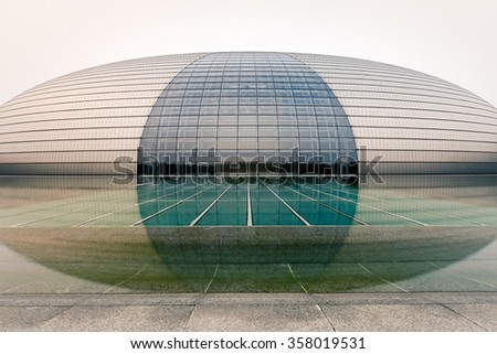 Beijing, China - on September 16, 2015:The beautiful scene of the National Grand Theater (National Center for the Performing Arts) of China in the dusk?One of the most famous landmarks of Beijing. - stock photo
