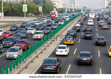 Beijing, China - on September 20, 2015: the urban road traffic jams during the rush hour due to the rising number of vehicles in Beijing, Beijing traffic congestion is more and more serious. - stock photo