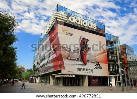 BEIJING, CHINA - SEPTEMBER 10, 2016:  Shoppers are seen around an Adidas store; Adidas, a German multinational corporation founded in 1948, is the second biggest sportswear manufacturer in the world.