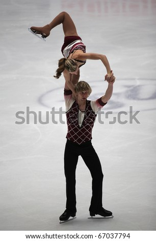 BEIJING-DEC 11: Ashley Cain and Joshua Reagan of USA perform in the Junior Pairs-Free Skating event of the ISU Grand Prix of Figure Skating Final on Dec 11, 2010 in Beijing, China. - stock photo