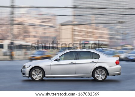 BEIJING-DEC. 6. BMW 3 Series. In the first half of 2013 BMW sold 183,000 cars and SUV�¢??s in China, a 15% surge. U.S. accounts for 173,000, a more sober 9% percent increase. Beijing, Dec. 6. 2013. - stock photo