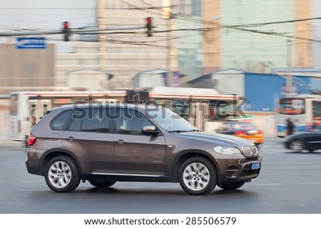 BEIJING-DEC. 12, 2013. BMW X 5. BMW's China sales have been outstanding last year. Growth in its wholesale volumes surged nearly 18% in first nine months of 2014, compared with same period in 2013. - stock photo