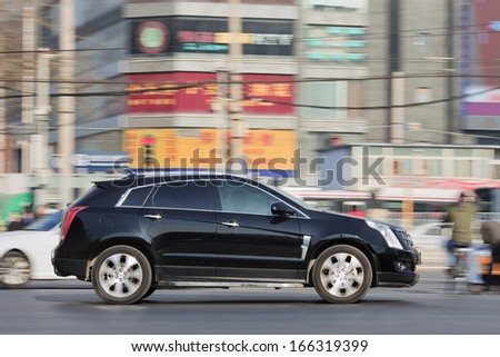 BEIJING-DEC. 12. Caddilac SRX SUV. GM wants to boost Cadillac and its luxury models. The company is starting to build Cadillacs in China that are designed for Chinese market. Beijing, Dec. 12. 2013. - stock photo