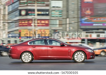 BEIJING-DEC. 6. Jaguar XF sedan. Despite a slowdown in the overall sales last year, China became Jaguar's biggest market. It currently has 151 authorized dealers in China. Beijing, Dec. 6. 2013. - stock photo