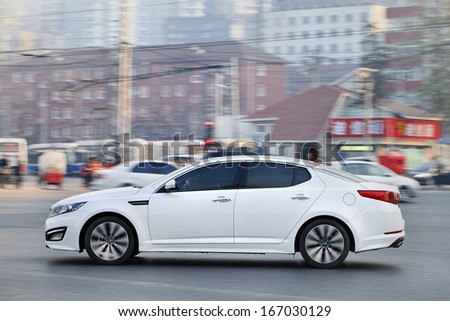 BEIJING-DEC. 6. Kia Optima. Hyundai and its affiliate Kia saw combined sales in China surge 25% in first nine months 2013, the year of mid-sized and sports utility vehicles. Beijing, Dec. 6, 2013. - stock photo