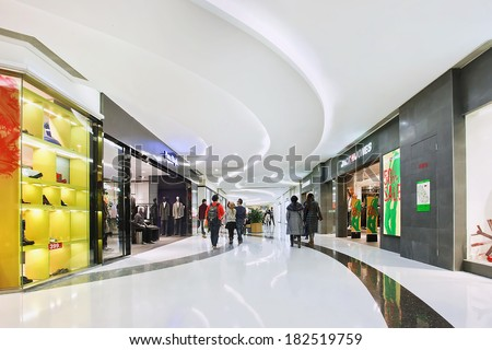 BEIJING-DEC. 29, 2013. Luxury shopping mall interior. Within a few years China becomes the largest luxury goods market. Its luxury market is forecast by McKinsey to soar to US$27 billion by 2015. - stock photo
