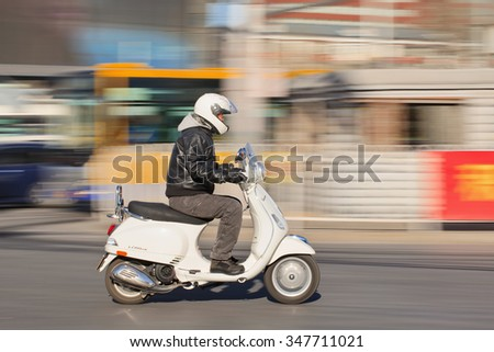 BEIJING-DEC. 5, 2015. Man on Vespa scooter LS 150. The LX scooters were launched in US in 2006 (60th anniversary Vespa), while S was added in 2008. Both models sold until 2014 before being replaced. - stock photo