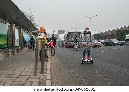 BEIJING - DEC 8: morning rush in Beijing on polluted day on December 8, 2015 in Beijing, China. The Chinese government issued the historical first Red Alert on air pollution on this day. - stock photo
