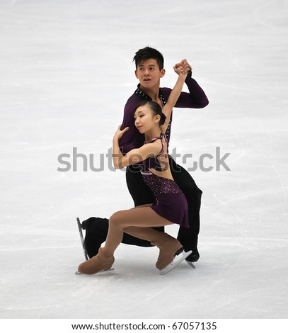 BEIJING-DEC 11: Narumi Takahashi and Mervin Tran of Japan perform in the Junior Pairs-Free Skating event of the ISU Grand Prix of Figure Skating Final on Dec 11, 2010 in Beijing, China. - stock photo