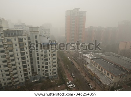 "BEIJING - DEC 1: Severe air pollution on December 1, 2015 in Beijing, China. Air quality index levels were classed as ""beyond index"" (PM 2.5 of over 500 micrograms per cubic meter).  - stock photo"