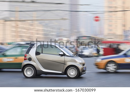 BEIJING-DEC. 6. Smart Car on the road. Smart Car sales in China grew 45% in 2012 to 15,680 vehicles. But given the size of China's car market, it is still a niche player. Beijing, Dec. 6, 2013. - stock photo