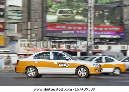 BEIJING- DEC. 6. Taxi on the road. Beijing, voted for having the world's worst commute, has raised taxi fares to entice cab drivers brave the morning and evening rush hours. Beijing, Dec. 6, 2013. - stock photo