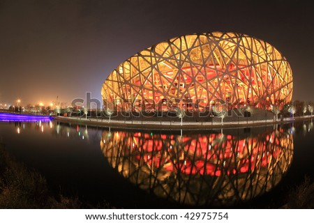 BEIJING - DECEMBER 16: The Beijing National Stadium, an Olympic arena, has become a new winter tourist spot after being converted into a ski playground on December 16, 2009 in Beijing, China. - stock photo