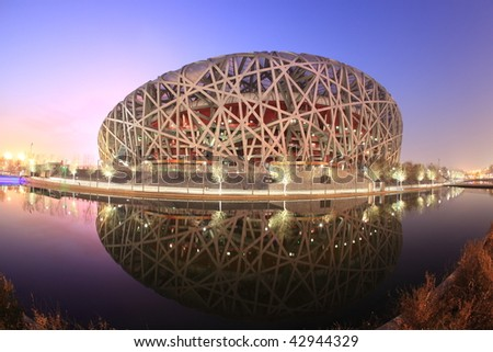 """BEIJING - DECEMBER 16: The Beijing National Stadium (""""The Bird's Nest""""), home to the 2008 Olympic games, was converted into a ski center in mid-December 2009, on December 16, 2009 in Beijing, China. - stock photo"""