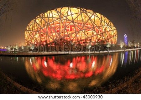 BEIJING - DECEMBER 17:  the transformation of the Beijing Olympic Stadium into a ski park made from artificial snow triggered environmentalists' anger on December 17, 2009 in Beijing, China. - stock photo