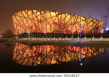 BEIJING - DECEMBER 17: the transformation of the Beijing Olympic Stadium into a ski park made from artificial snow triggered green peace activitists' anger on December 17, 2009 in Beijing, China. - stock photo
