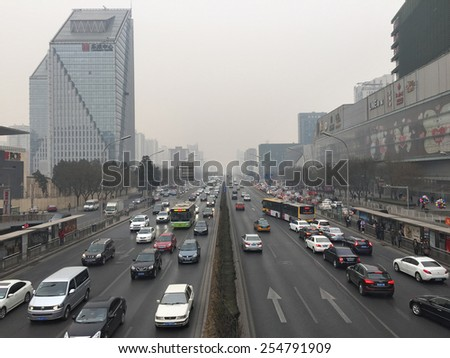 "BEIJING - FEB 25: severe air pollution on February 25, 2014 in Beijing, China. Air quality index levels were classed as ""Beyond Index"" (PM 2.5 of over 500 micrograms per cubic meter).  - stock photo"