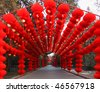 BEIJING - FEBRUARY 13: A colored long corridor decored with red lanterns and other traditional Chinese decorations are on display at Ditan Park on February 13, 2010 in Beijing, China - stock photo