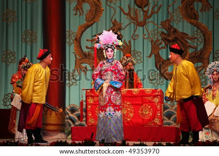 "BEIJING - FEBRUARY 19: Actors of the China National Peking Opera Company perform the Peking Opera ""The Red Haired Galloping Horse"" at Meilanfang theatre on February 19, 2010 in Beijing, China"