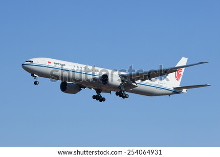 BEIJING-FEBRUARY 18, 2015. Air China B-2089, Boeing 777-300 landing in Beijing. Boeing 737 is a short- to medium-range twin-engine narrow-body jet airliner, originally developed as low-cost airliner. - stock photo