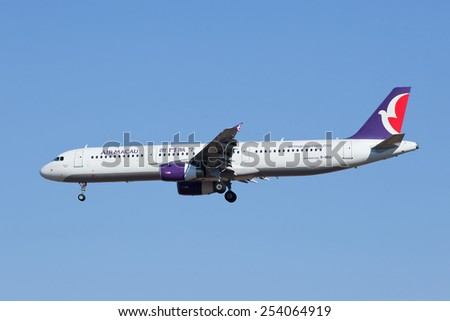 BEIJING-FEBRUARY 18, 2015. Air Macau B-MBA, Airbus A321, landing in Beijing. The Airbus A321 is a two-engine short- to medium-range narrow body airliner for a capacity of maximum 220 passengers.  - stock photo