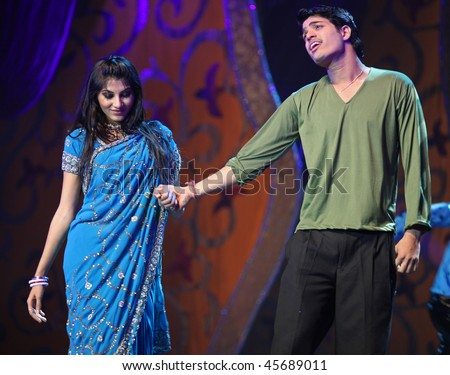 BEIJING - JANUARY 31: An Indian couple perform a romantic scene on stage during Indian Music and Dance Show at Beijing Exhibition Theater on January 31, 2010 in Beijing, China. - stock photo