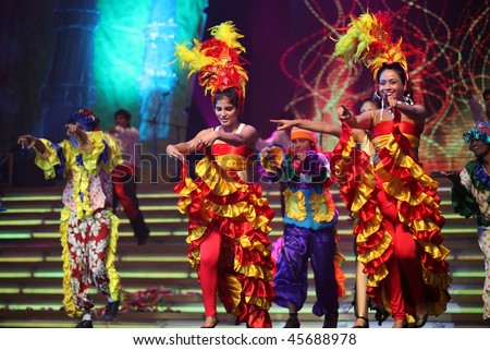 BEIJING - JANUARY 31: Dancers wear colorful outfit perform on stage during Indian Music and Dance Show at Beijing Exhibition Theater on January 31, 2010 in Beijing, China. - stock photo